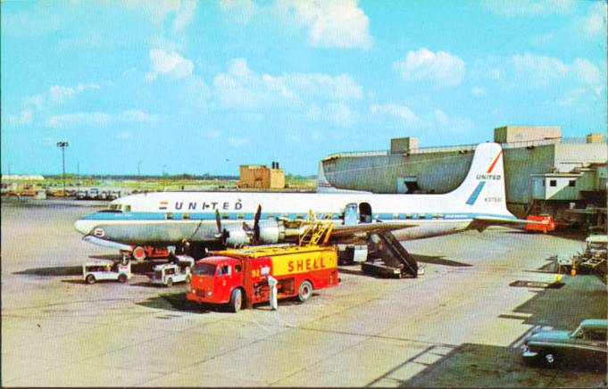 MUNICIPAL AIRPORT - UNITED PLANE BEING FUELED FROM SHELL TRUCK - 1950