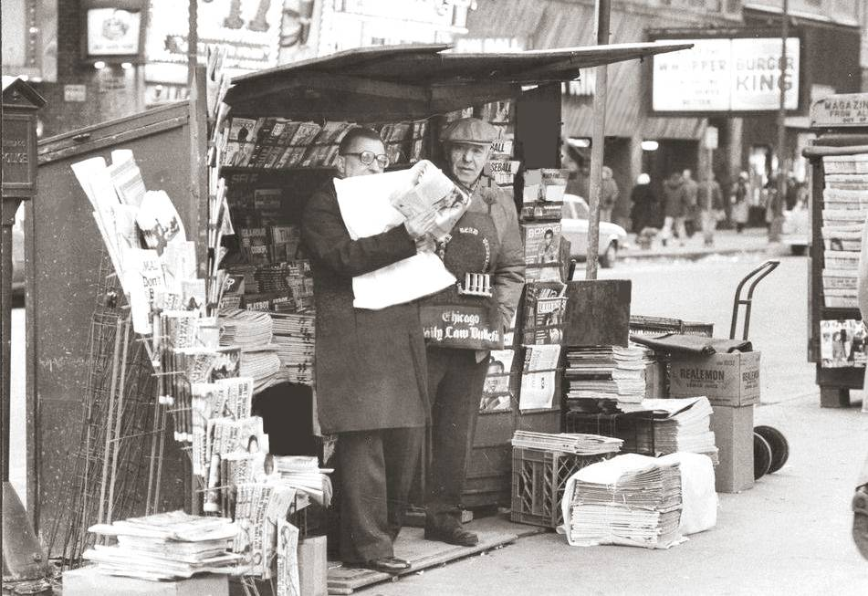 PHOTO - CHICAGO - NEWS STAND - VENDOR AND CUSTOMER - DOWNTOWN STREET - EDITED FROM A TRIBUNE IMAGE
