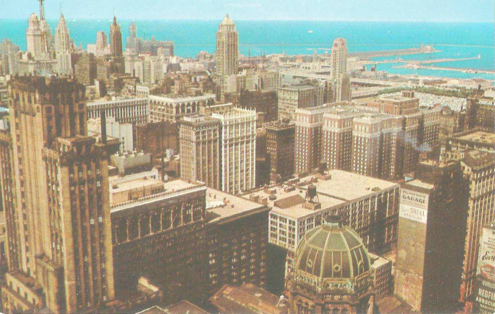 POSTCARD - CHICAGO - PART OF SKYLINE - AERIAL - LOOKING NE - OLD POST OFFICE IN FOREGROUND - 1957